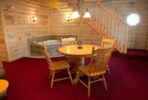 Dining Table & Jacuzzi Tub in the Hummingbird Haven Cabin in Berlin, OH