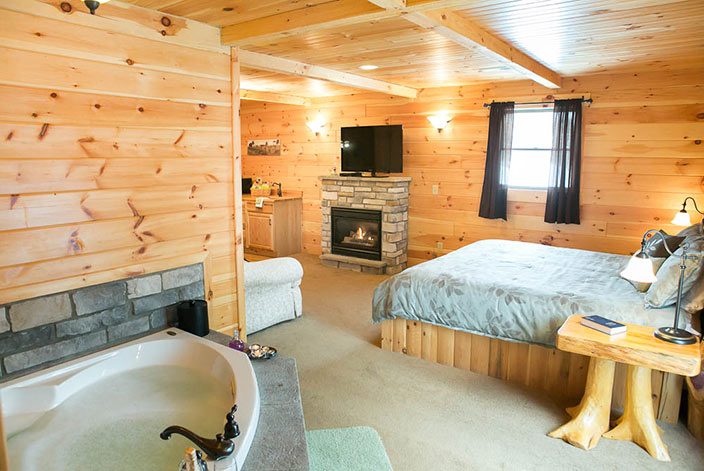 Jacuzzi Tub, Bed & Fireplace in a Millersburg Ohio Bed and Breakfast