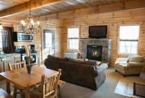 Sugar Maple Cabin Rental in Berlin, OH - Fireplace & Living Area