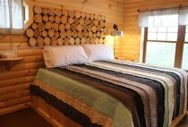 Bed in an Amish Country Cabin Rental with Hot Tub