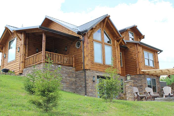 Image of a large log cabin
