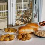 A full spread of cookies, pie and bread