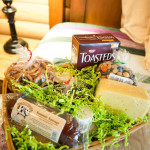 A gift basket of cheese and crackers