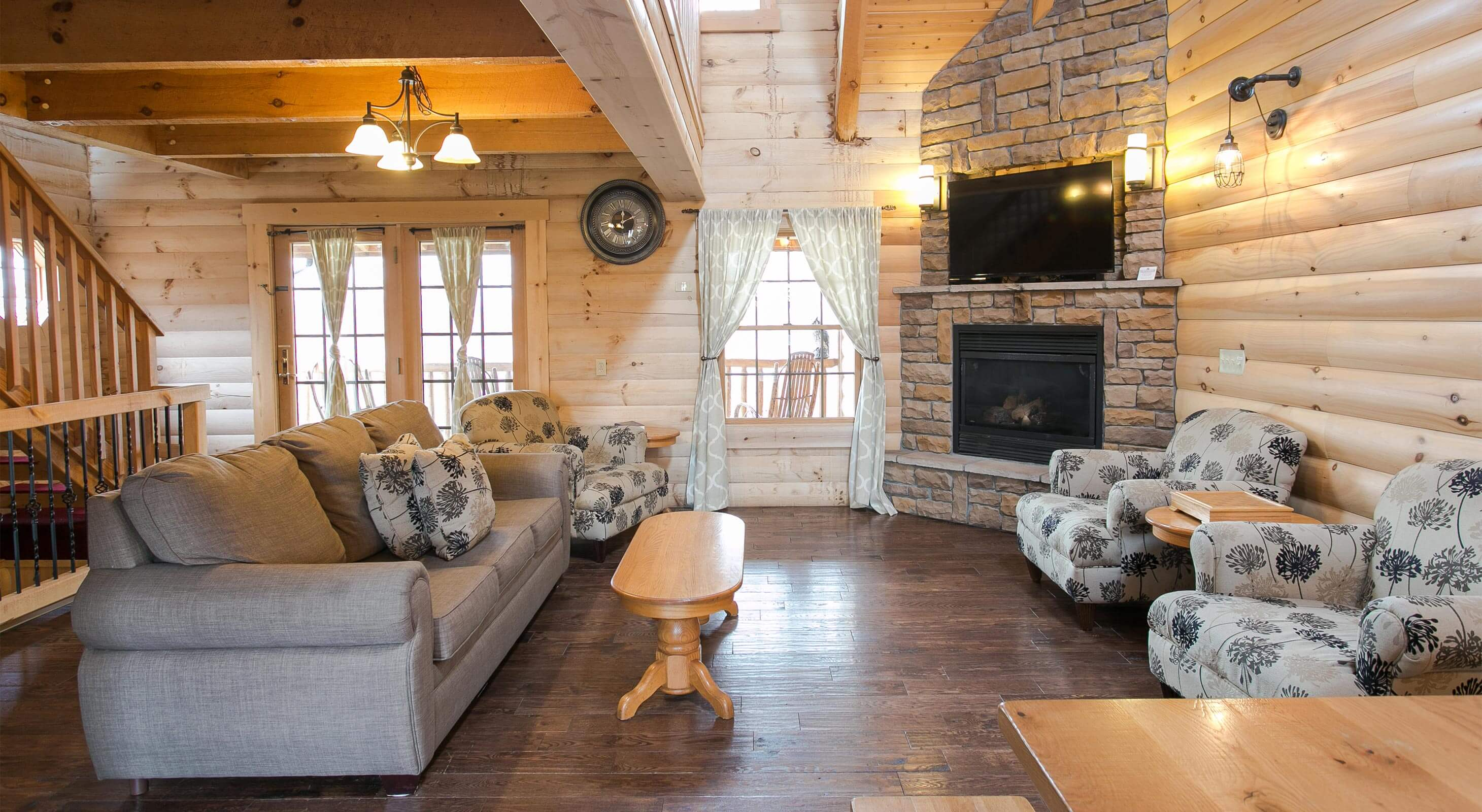 Living Room with rock fireplace in Hummingbird Haven