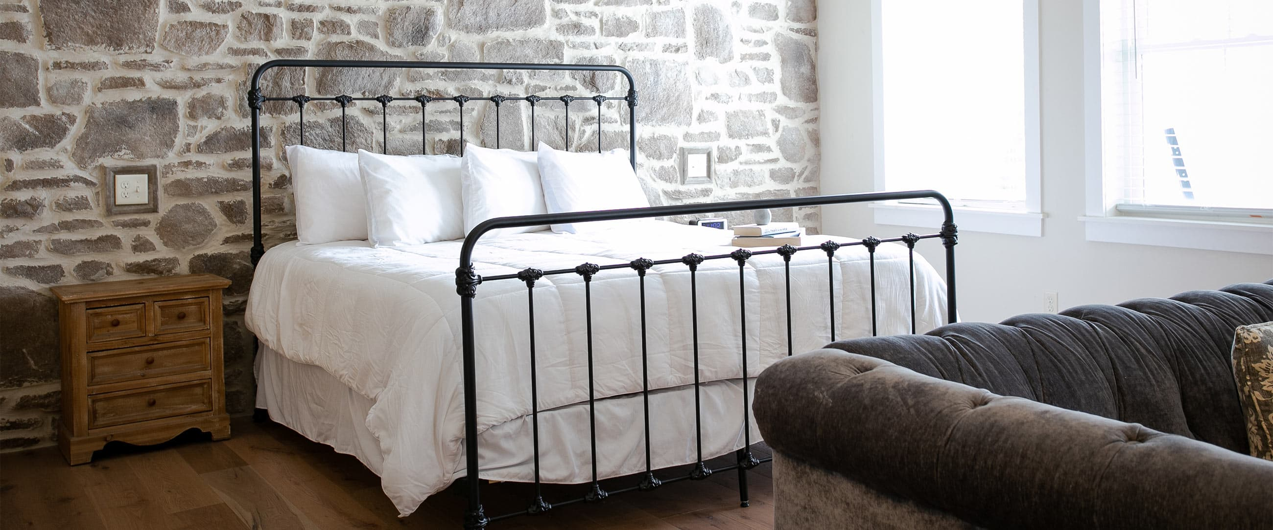 Magnolia suite bed against stone wall