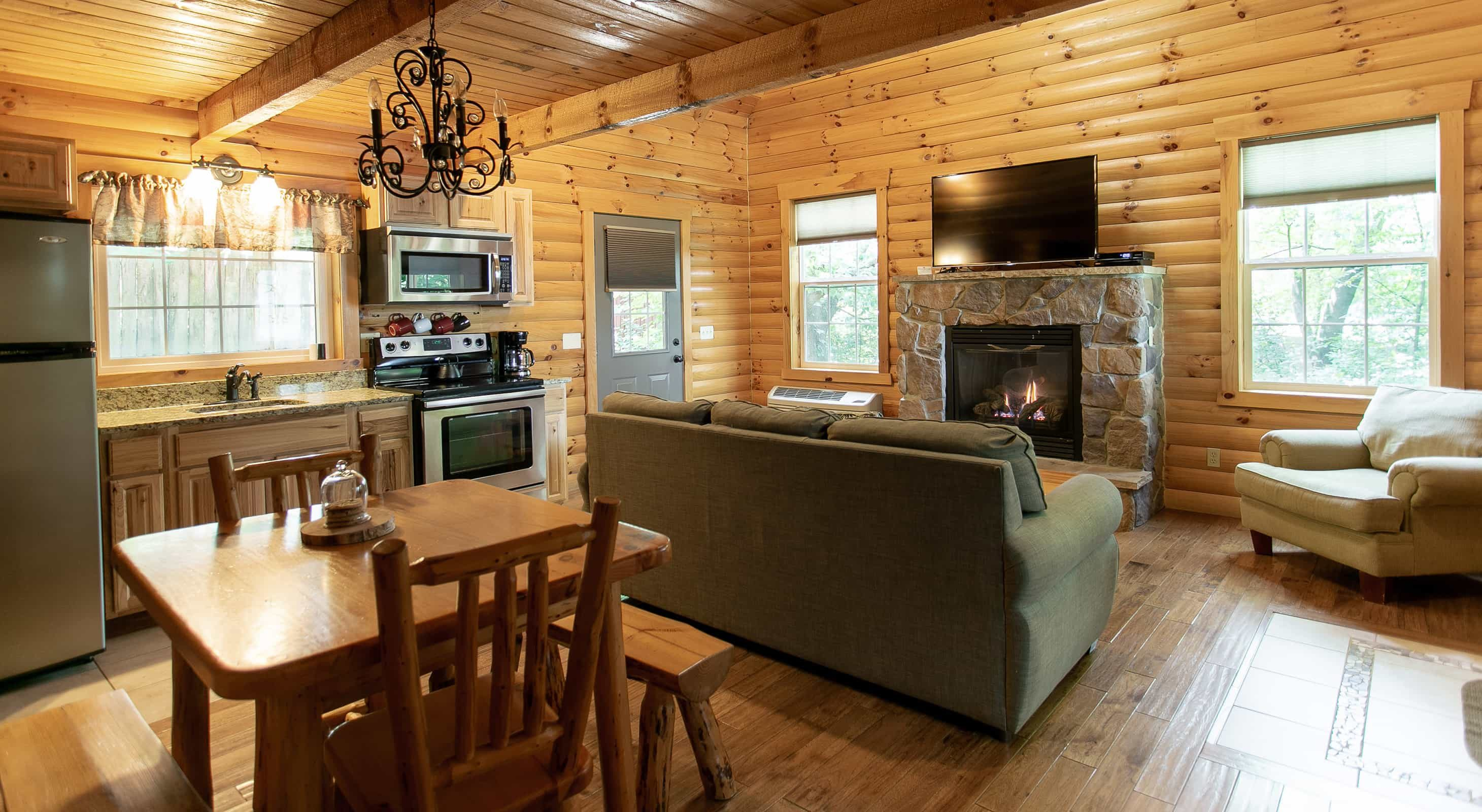 Living room with fireplace in the Sugar Maple Log Cabin
