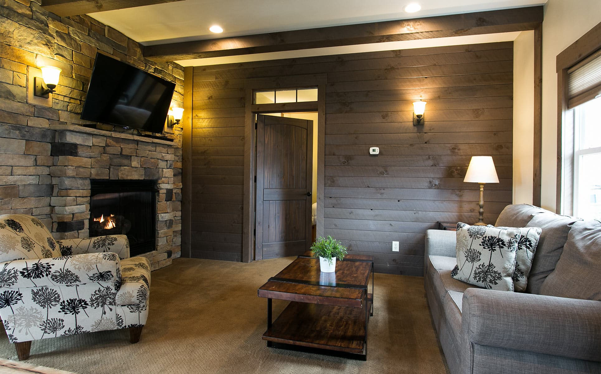 Living room with Gas Fireplace and wood wall