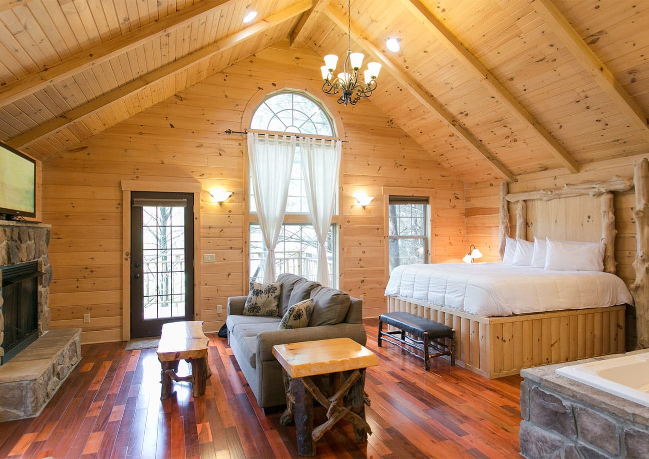 Bed, Living Area, and Tub in Whispering Pines Tree House