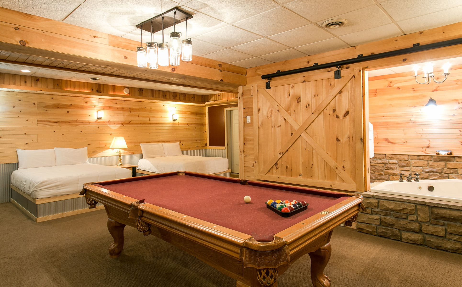 Pool Table with beds in basement