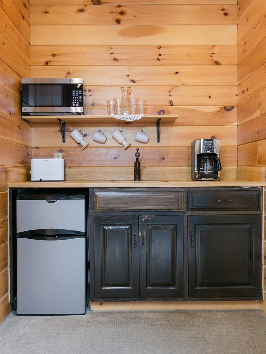 Kitchenette with coffee maker, toaster, microwave, and fridge