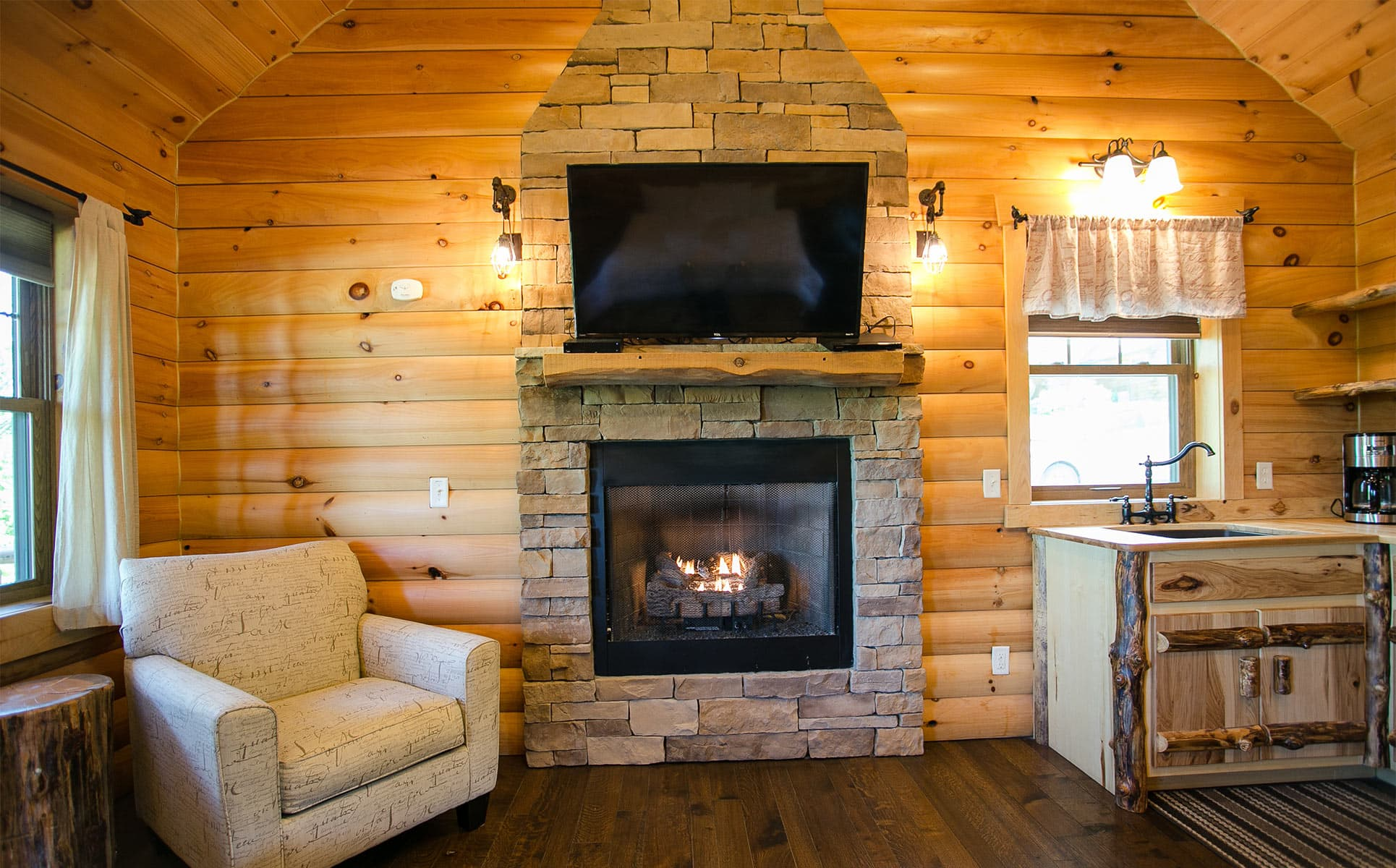 stone fireplace and chair