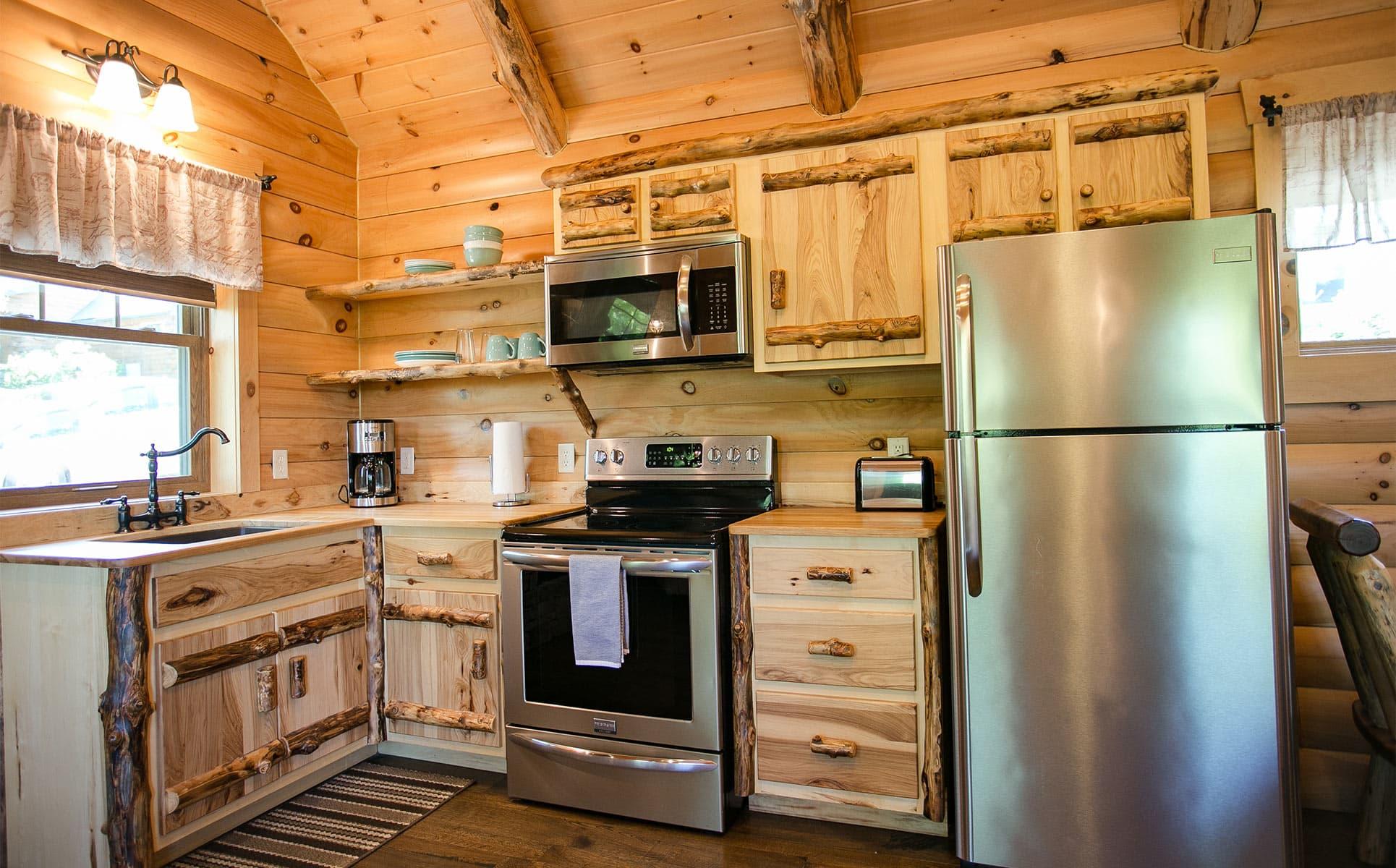 Full Kitcen with range, microwave, and fridge