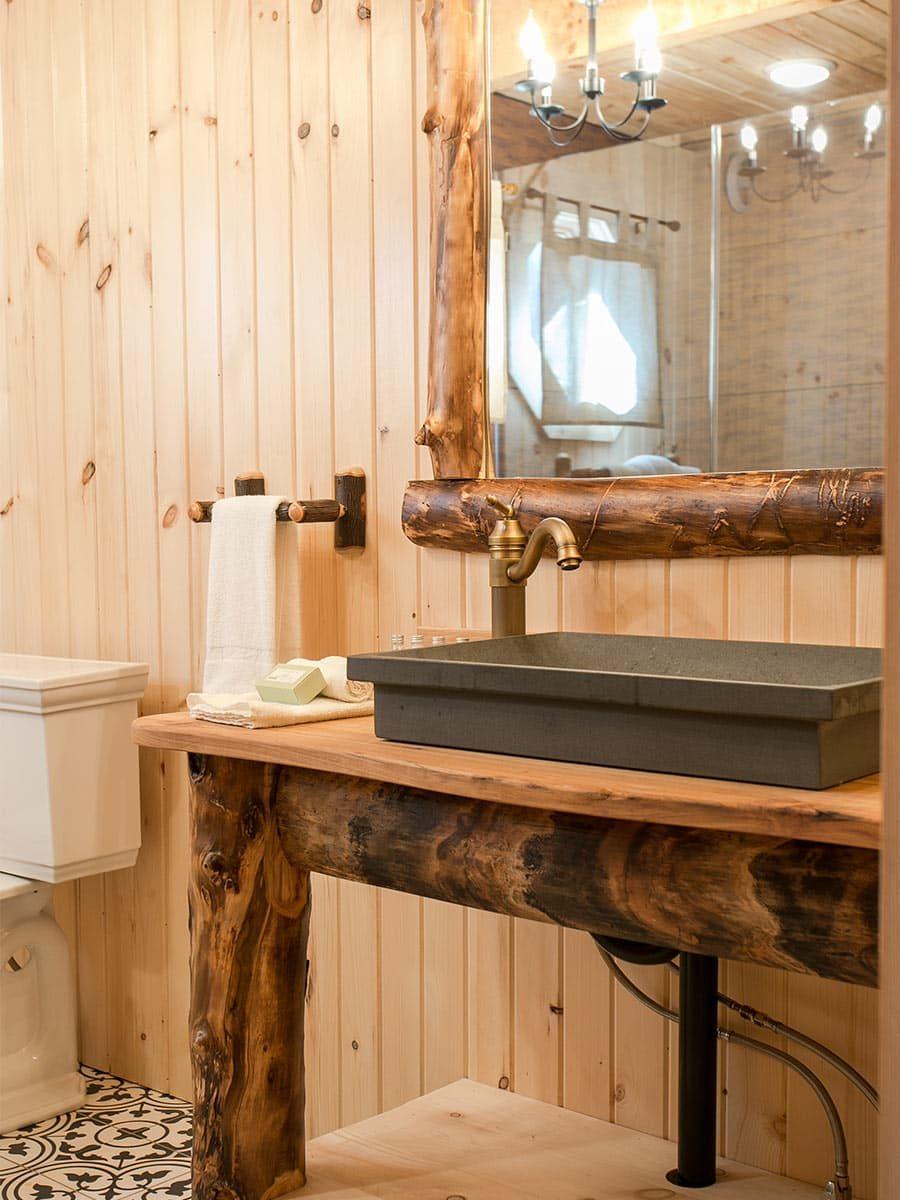 Bathroom with wood vanity and vesell sink