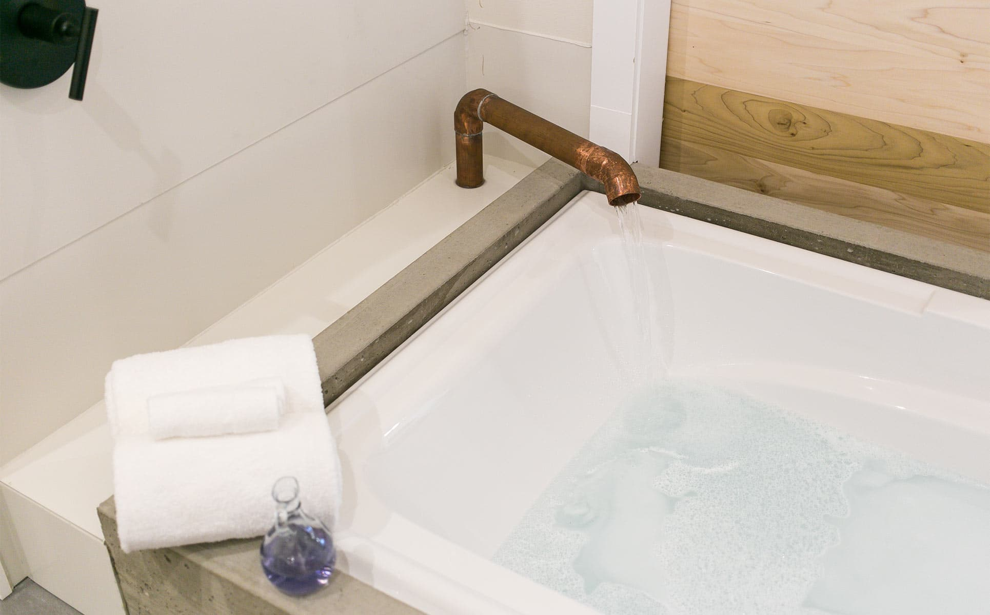 Jetted tub with copper faucet