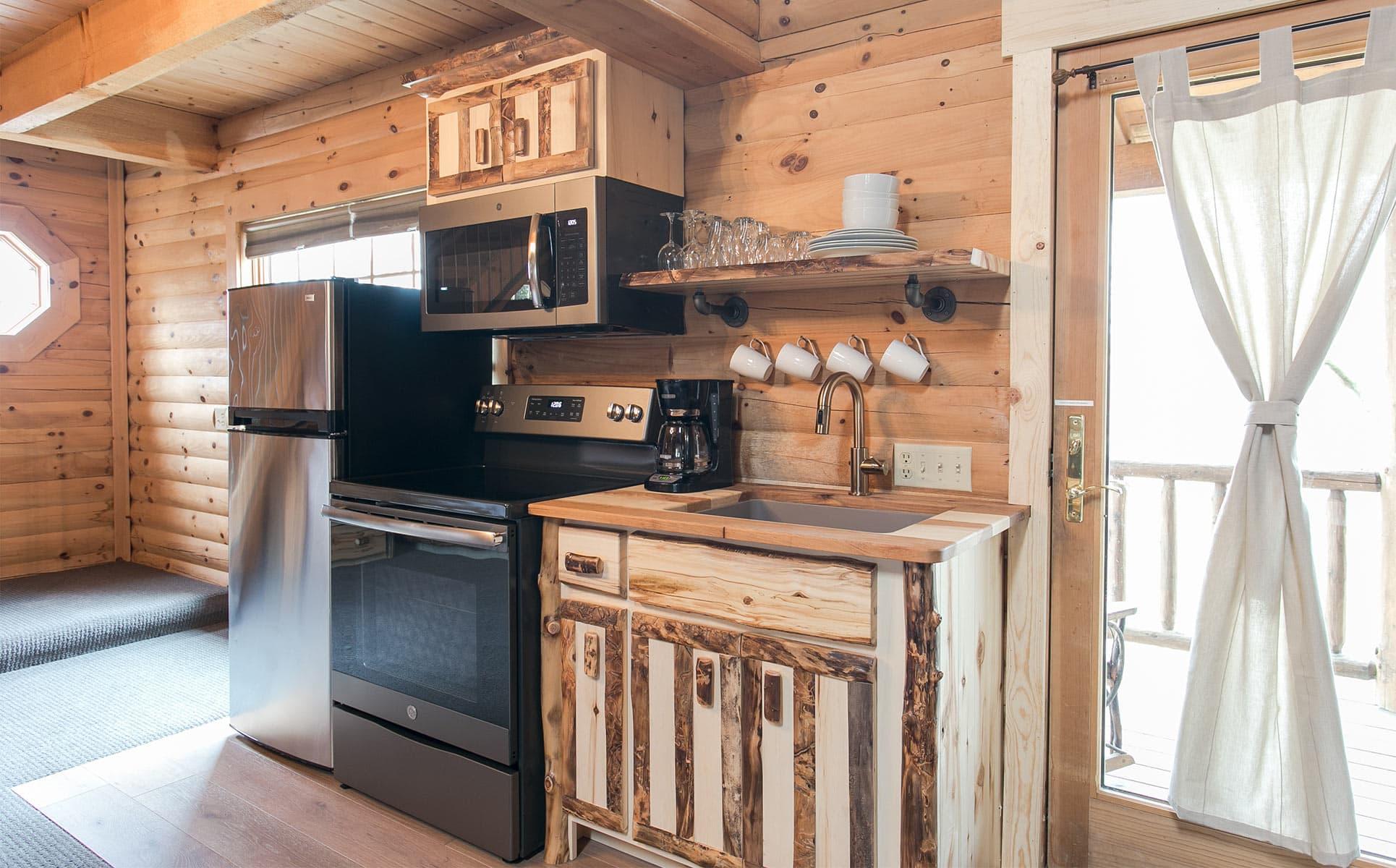 Kitchen with range, micro, and fridge