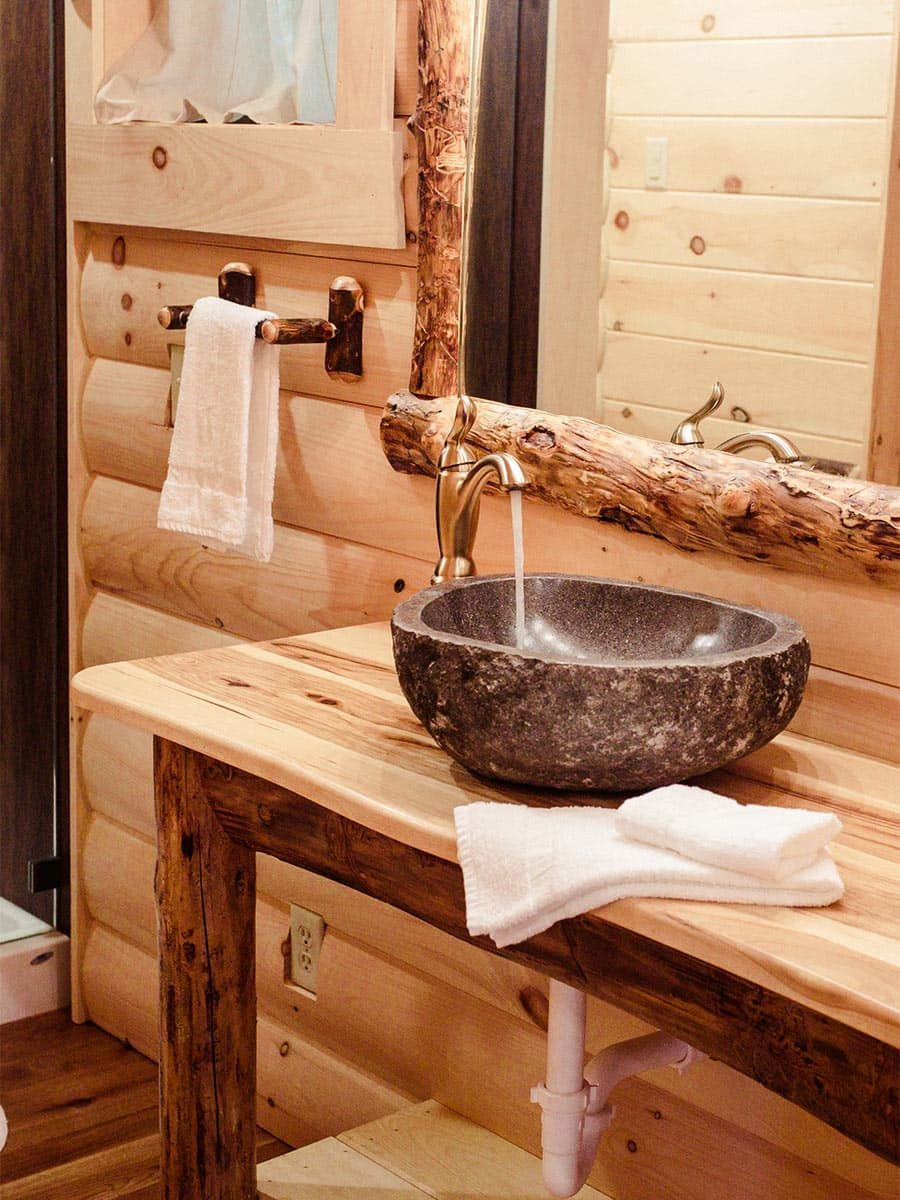 Vessel sink on wood vanity in bathroom