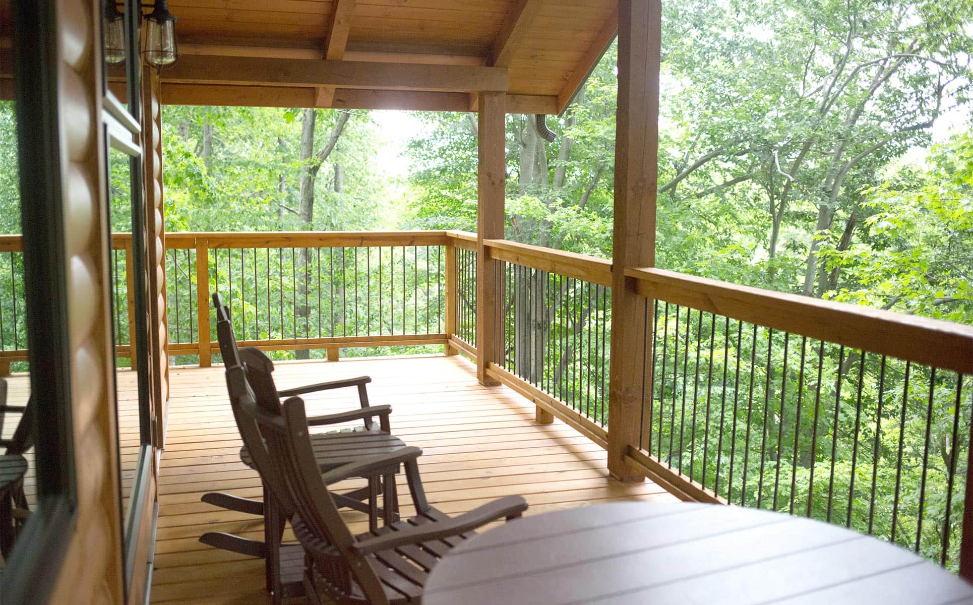 Deck with rocking chairs and view of the trees