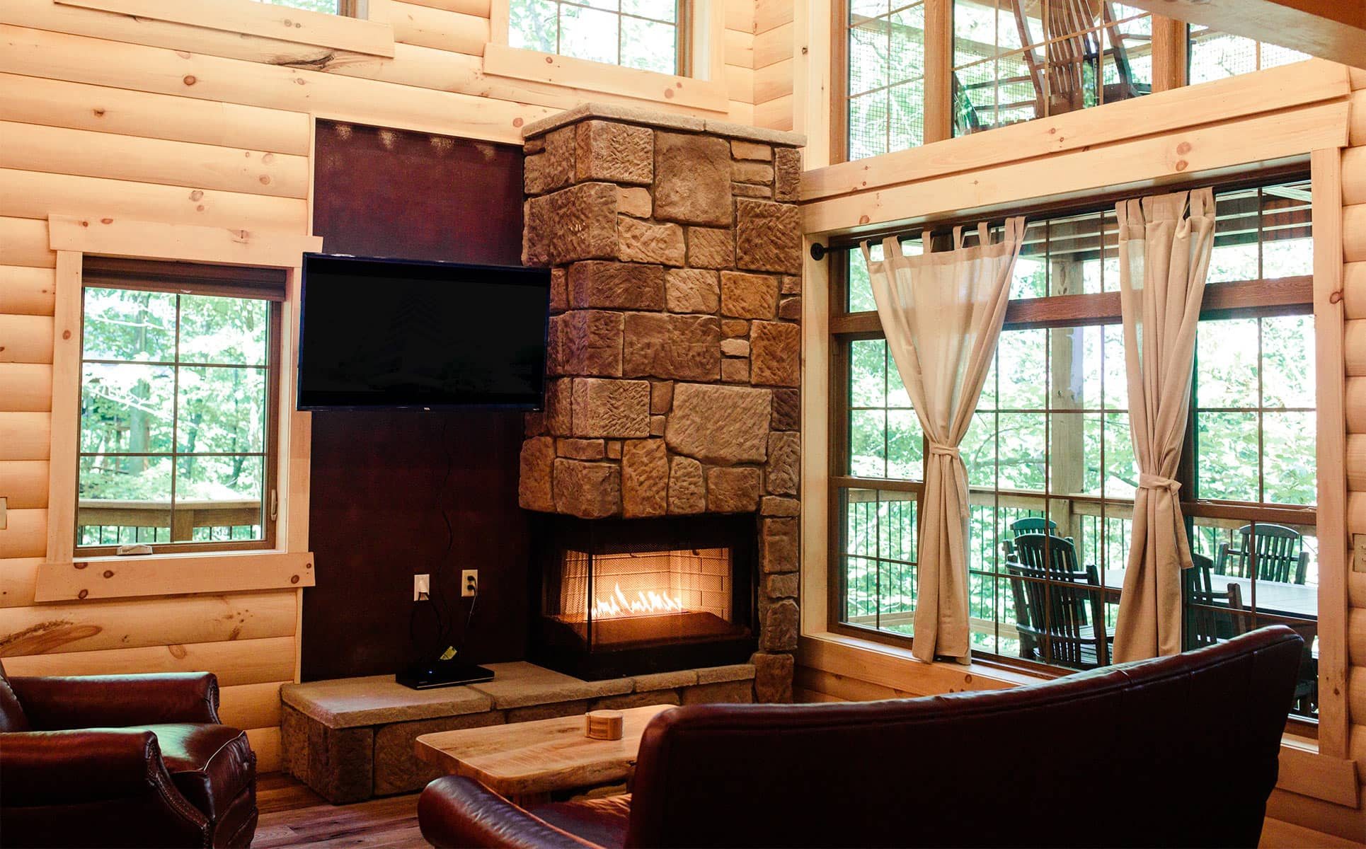 Fireplace, tv,  and tall windows