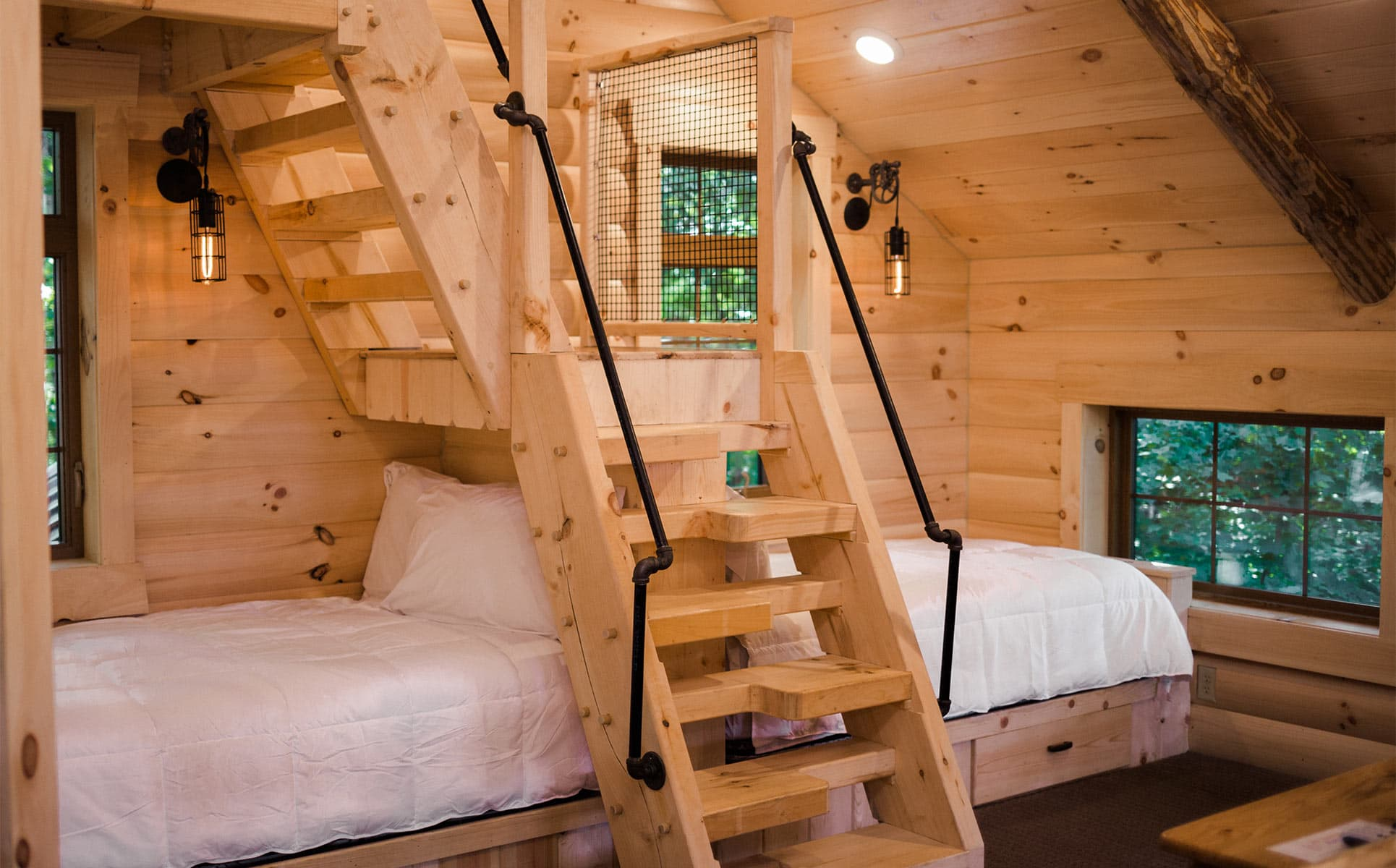 Twin beds in the loft with stairs to crows nest
