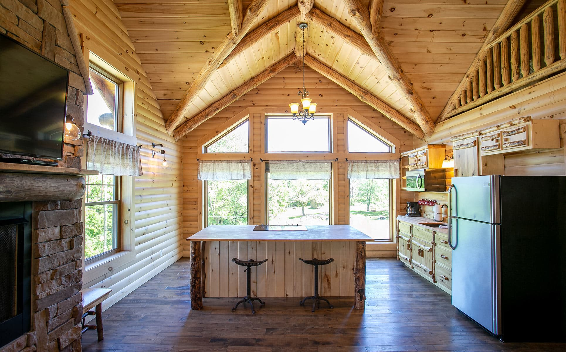 Kitchen area with vaulted ceiling