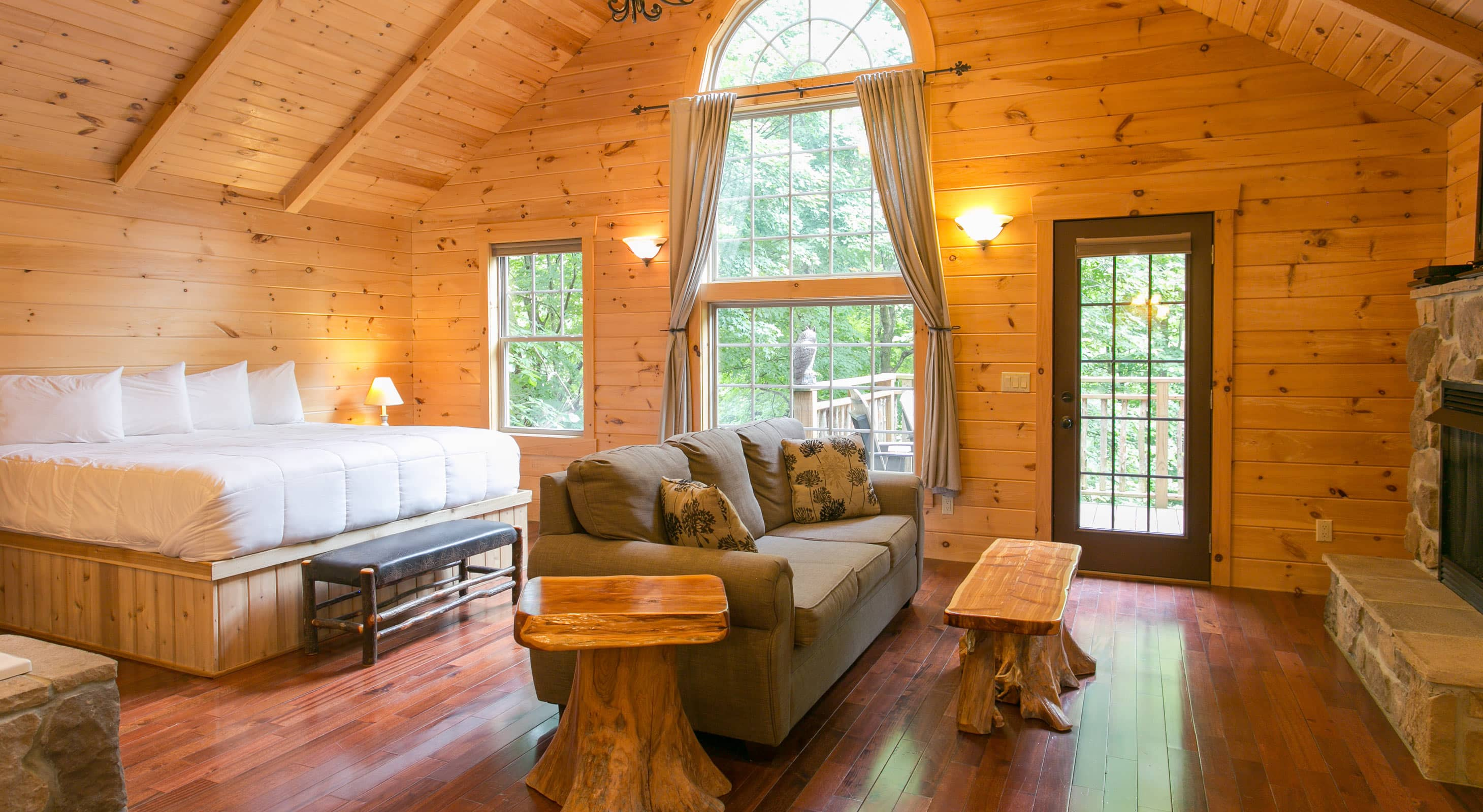 Interior of Treehouse with bed, couch, & stone detail