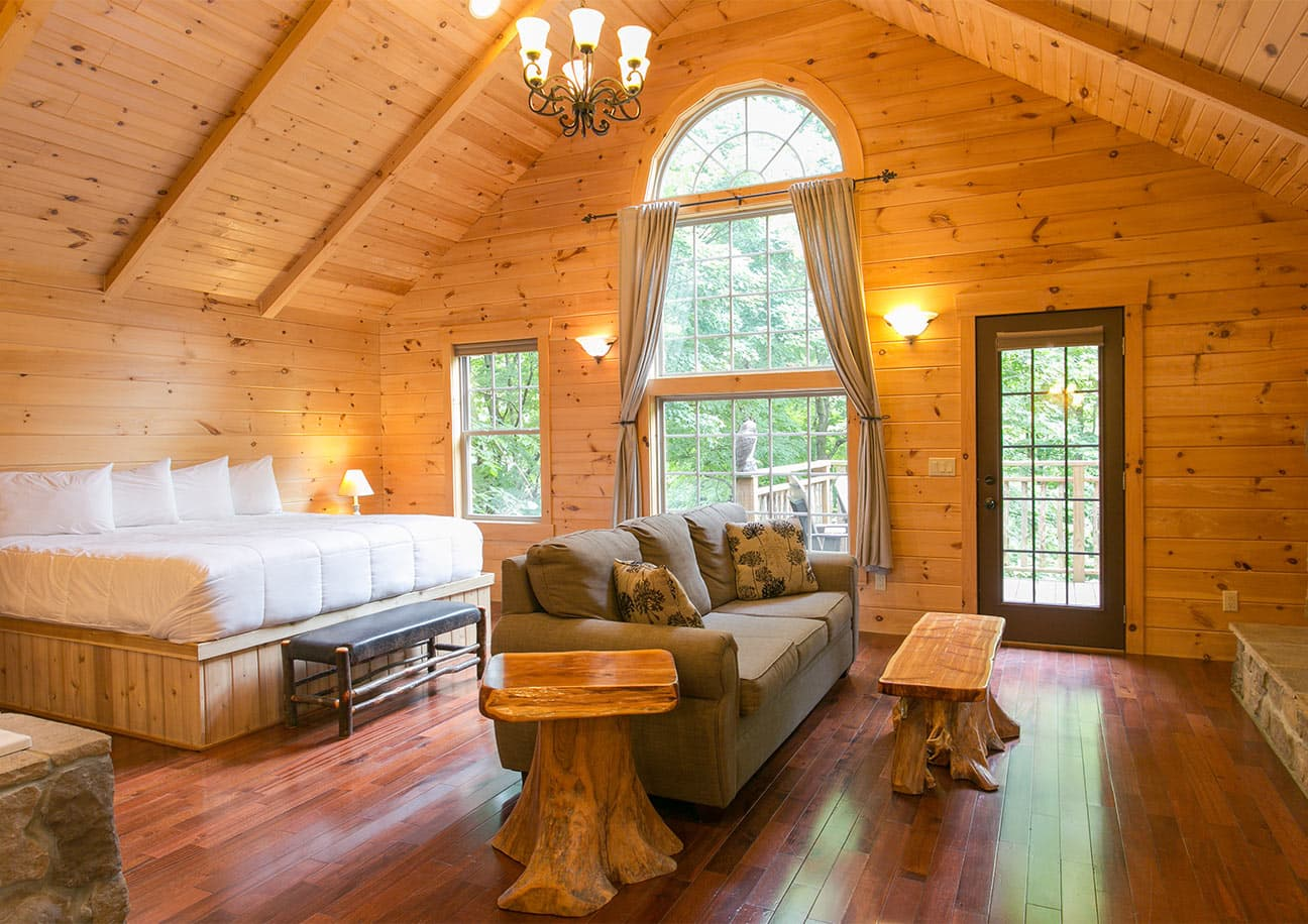 Interior of Tree House with bed, couch, & stone detail