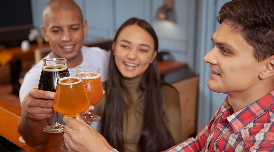 friends tasting beer at Millersburg brewery - top 10 things to do in Amish country